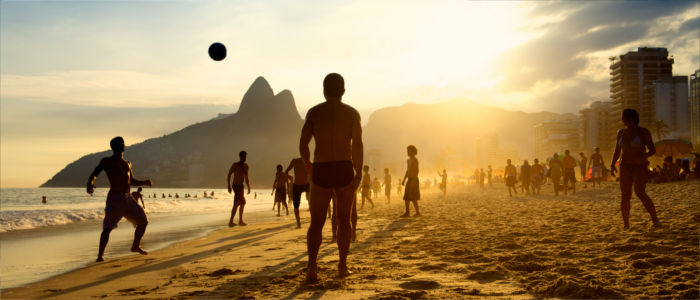 Playing football at the beach in Brazil