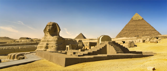 Sphinx in Giza with Khufu Pyramid in Egypt