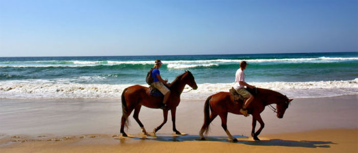 Riding along the beach in Mozambique