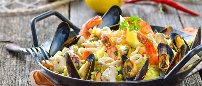 Mixed paella made with meat and prawns