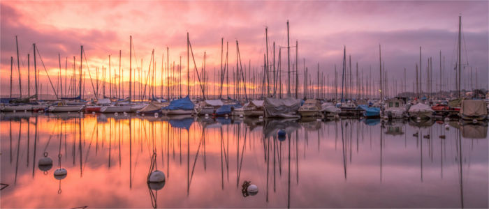 Sailing boats at sunset in Geneva